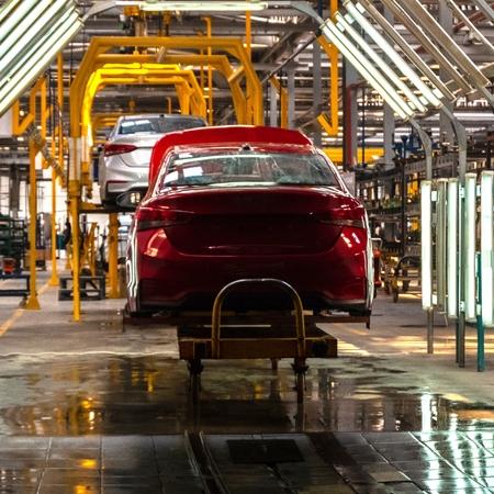 Foto de The body of the red car on the production line. Plant vehicles or car repair shop or auto tuning studio. Square frame - Imagen libre de derechos