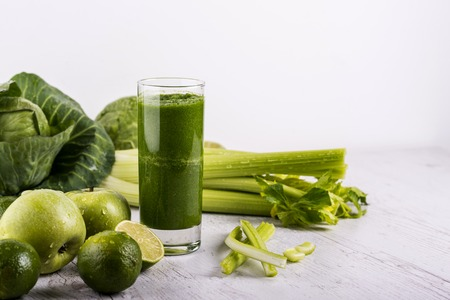 Photo for Blended green smoothie with ingredients on wooden table. Dexox drink - Royalty Free Image
