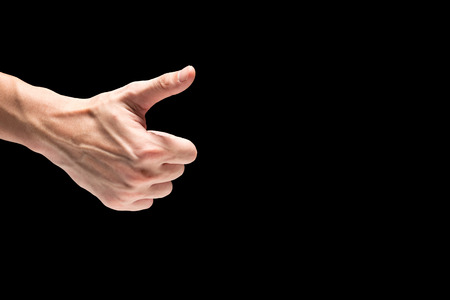Photo for Male hand on a black background. Free space for text - Royalty Free Image