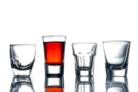 Photo pour Collage of glasses with alcohol on a white background. - image libre de droit