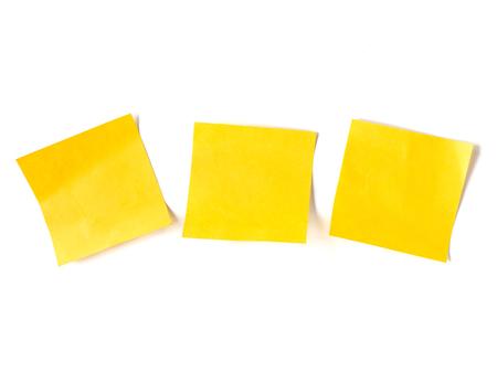 Photo pour Yellow stick notes paper on white background. - image libre de droit