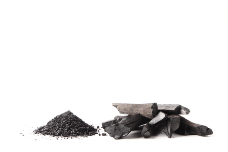 Photo pour Charcoal and powder (activated carbon) on white background. Free space for text - image libre de droit
