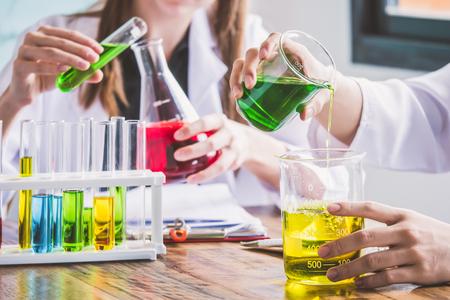 Foto de Couple of students working at chemistry class. Education concept - Imagen libre de derechos