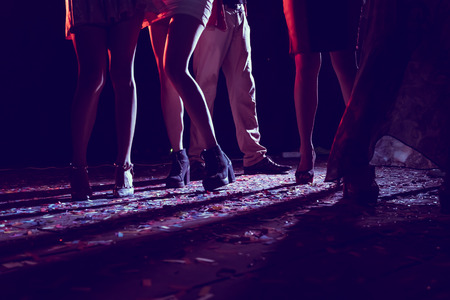 Photo for Legs of dancing people at the party. - Royalty Free Image