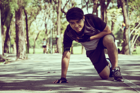 Foto für An Asian man has a heart pain while exercising in a park. - Lizenzfreies Bild
