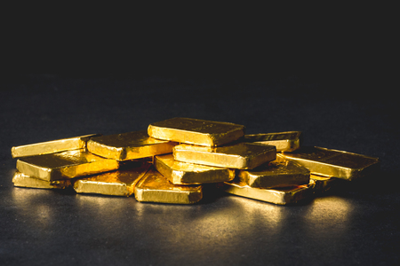 Photo pour Stack of Pure gold bars on black background - image libre de droit