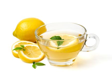 Photo pour A cup of tea and lemon on a white background - image libre de droit