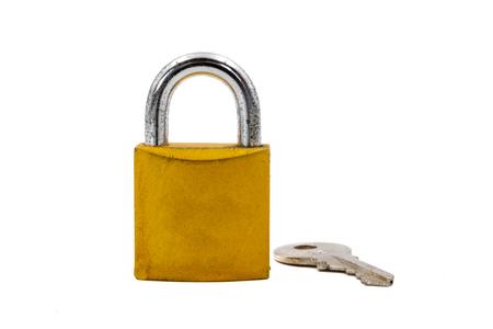 Foto de Golden padlock with key on white background - Imagen libre de derechos