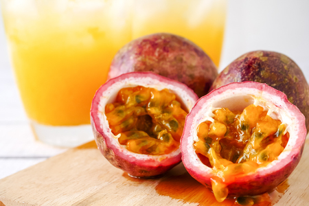 Photo for Fresh passion fruit and juice on wooden table. - Royalty Free Image