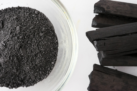 Photo for Activated charcoal powder on white background - Royalty Free Image