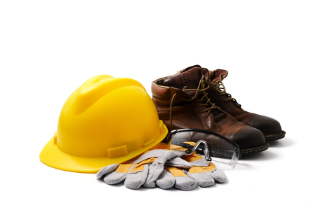 Photo pour Construction site safety. Personal protective equipment on white background - image libre de droit