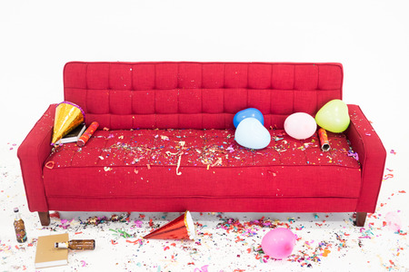 Photo for Chaos on the red sofa after new year party - Royalty Free Image