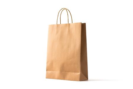 Photo pour Brown paper shopping bag on white - image libre de droit