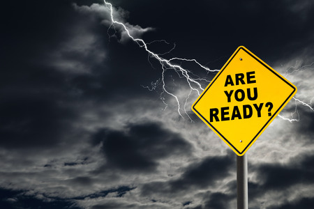 Foto de Are You Ready road sign against a dark, cloudy and thunderous sky. Conceptually warning of danger ahead. - Imagen libre de derechos