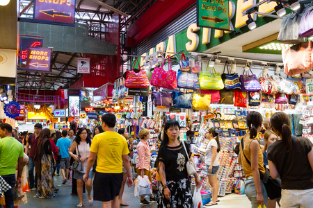 Photo for SINGAPORE - SEPTEMBER 7 ,2017: Shoppers at the famous Bugis Street Market, a bargain place renowned for cheap food; clothing, souvenirs, electronics, houseware and cosmetics. - Royalty Free Image