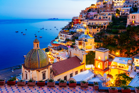 Foto de Positano, Amalfi Coast in Campania, Sorrento, Italy. View of the town and the seaside in a summer sunset - Imagen libre de derechos