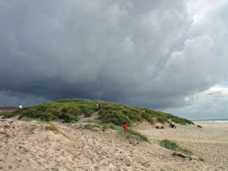 Heavy dark clouds formation on a beach in a stormy winter day