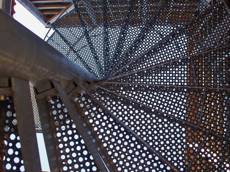 Photo pour Upside view of a metal spiral staircase abstract architecture background image - image libre de droit