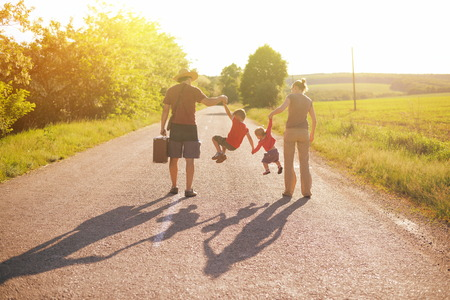 Photo for silhouette of family walking in park on sunrise - Royalty Free Image