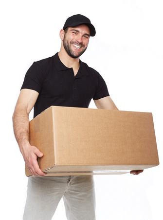 Photo pour Smiling delivery man giving cardbox on white background - image libre de droit