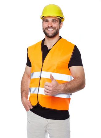 Foto de Portrait of smiling worker in a reflective vest isolated on white background  - Imagen libre de derechos