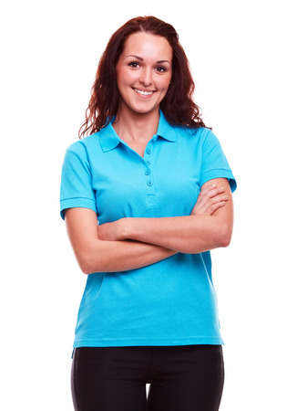Photo for Smiling woman in blue polo shirt with arms crossed, on a white background - Royalty Free Image