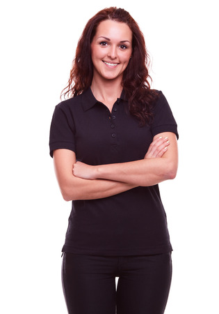 Photo for Smiling woman in black polo shirt with arms crossed, on a white background - Royalty Free Image