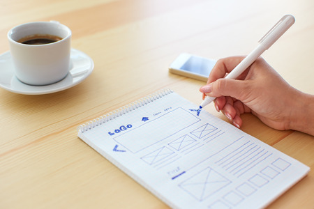 Foto de Graphic designer sketching webdesign behind the desk - Imagen libre de derechos