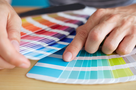 Photo pour Graphic designer choosing a color from the palette - image libre de droit
