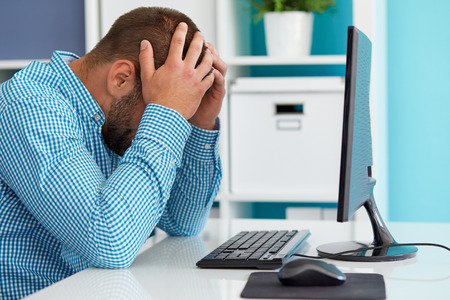 Photo for Young business man under stress with headache - Royalty Free Image