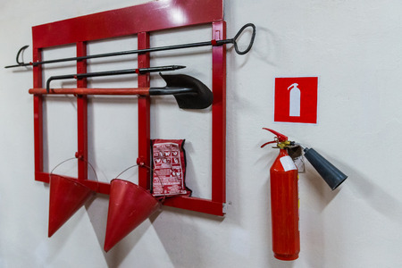 Photo pour Red fire stand with fire extinguishing tools. - image libre de droit