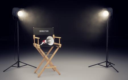 Foto de Film director's chair with megaphone and spotlights shining - Imagen libre de derechos