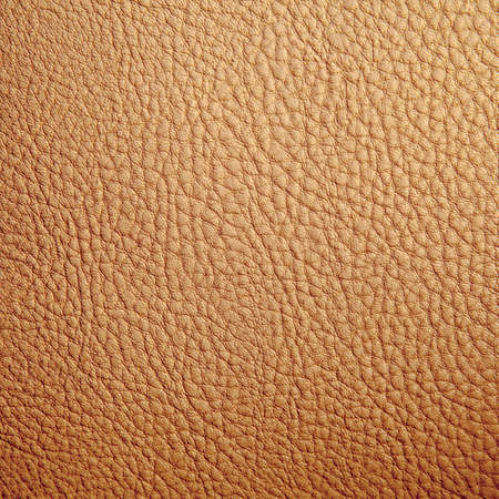 Tan leather texture background  Close-up photo