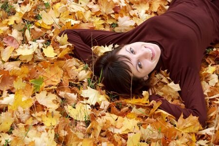 Girl in the autumn leafs. Element of design.