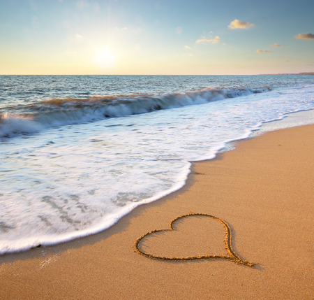 Foto de Heart on beach. Romantic composition. - Imagen libre de derechos