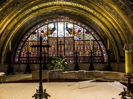 Foto de MOUNT TABOR, ISRAEL, July 10, 2015: Ornate stained with peacocks and gilding in the Church of the Transfiguration on Mount Tabor in Israel - Imagen libre de derechos