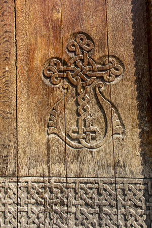 Photo pour A fragment of an old wooden door in the monastery of Armenia - image libre de droit