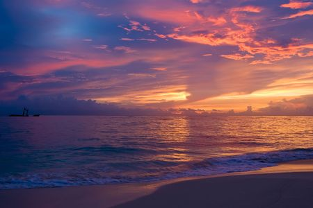 Photo for Yellow red pink blue sunset on the ocean in summer - Royalty Free Image