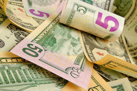 Foto de Cash dollars lying on the plane. - Imagen libre de derechos