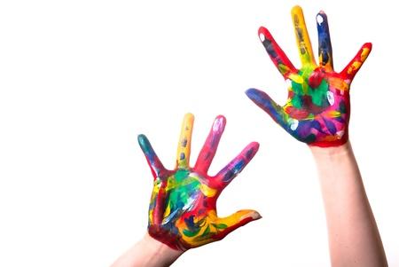 Foto de two painted colorful hands with space for text on a white background - Imagen libre de derechos