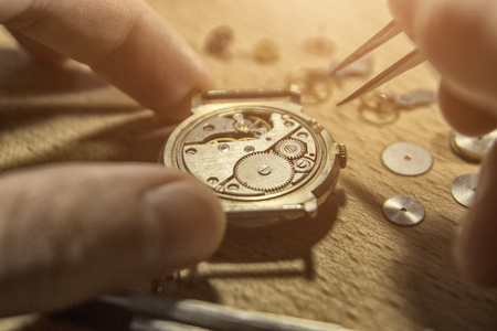 Photo for Watchmaker is repairing the mechanical watches in his workshop - Royalty Free Image