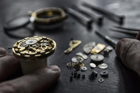 Foto de Watchmaker's workshop, watch repair, special tools for watch, background - Imagen libre de derechos
