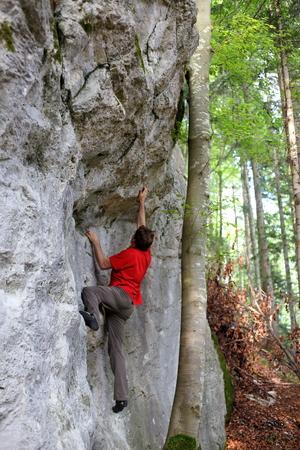 climbing sports man on a rock wall