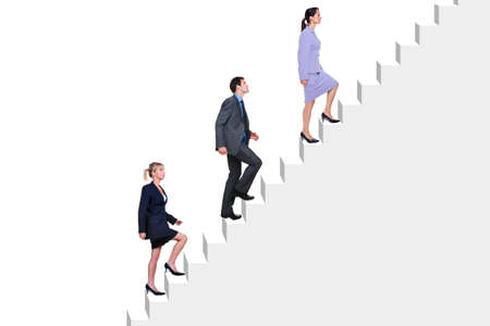 Three business people climbing a flight of stairs, white background.