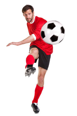 Photo pour a footballer or soccer player cut out on a white background,. - image libre de droit