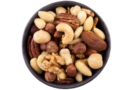 Photo for Large diversity of healthy nuts in a dark bowl - isolated - Royalty Free Image