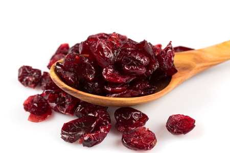 Photo for Pieces of dried cranberries isolated on white background - Royalty Free Image