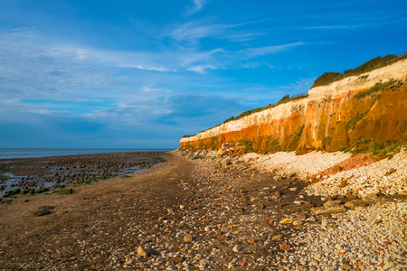 Photo for View of the beach with chalk and brownstone cliffs in Hunstanton, Norfolk UK - Royalty Free Image