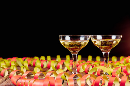 Photo for Two glasses of wine and papper ribbons and copyspace - Royalty Free Image