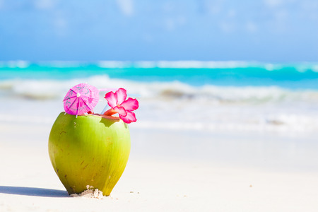 Photo for two fresh coconut cocktail on tropical beach with flower - Royalty Free Image